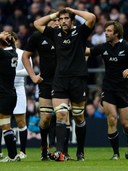 New Zealand players react during their test against England at Twickenham. REUTERS/Dylan Martinez