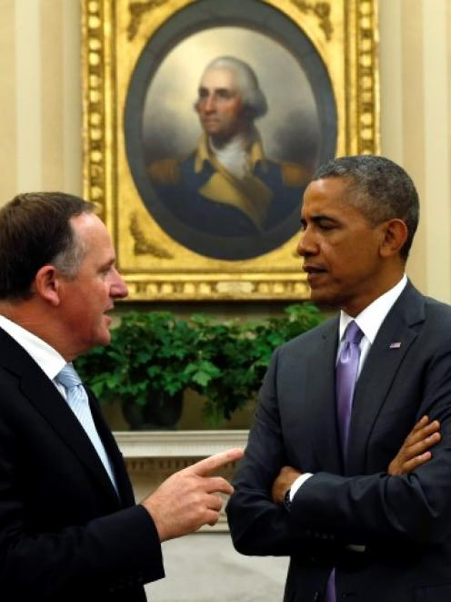 New Zealand Prime Minister John Key (L) speaks with US President Barack Obama in the Oval Office...