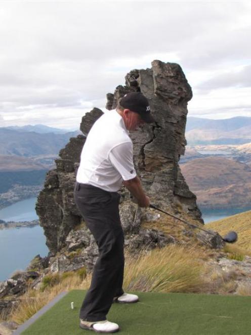 New Zealand Prime Minister John Key tees off at a novelty par 3 golf hole on Cecil Peak on...