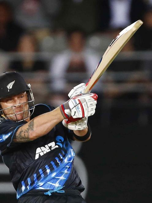 New Zealand's Brendon McCullum hits out on his way to 74 off 38 balls.  REUTERS/Simon Watts