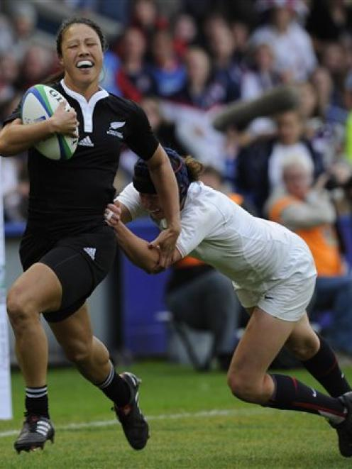 New Zealand's Carla Hohepa, left, is tackled by England's Joanna McGilchrist during their Women's...