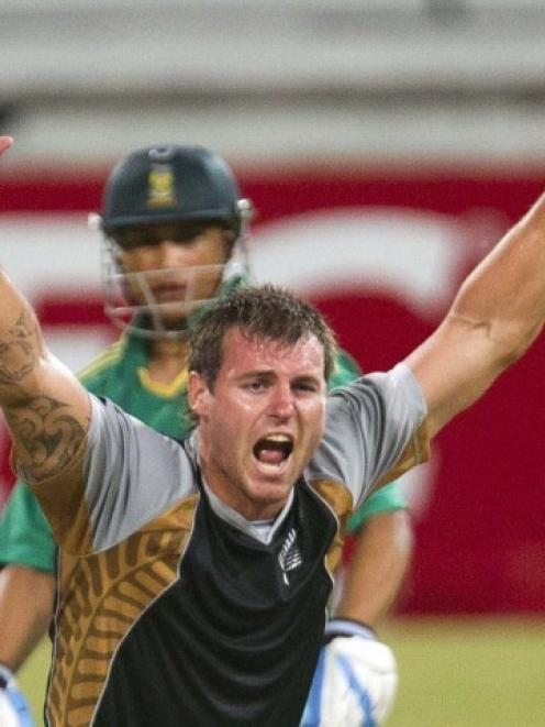 New Zealand's Doug Bracewell appeals unsuccessfully for the wicket of South Africa's Henry Davids...