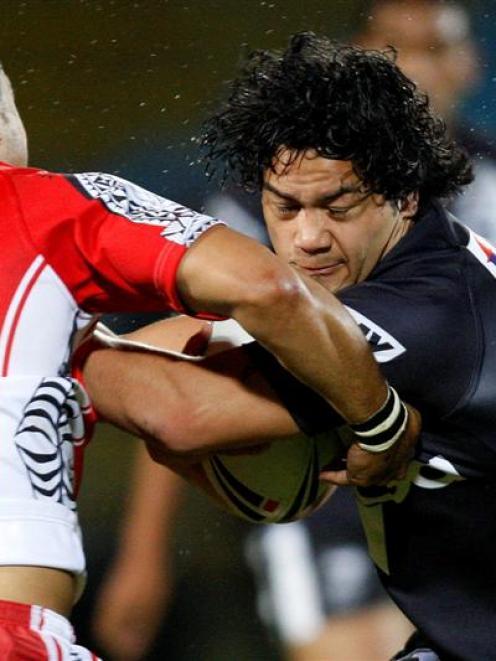 New Zealand's Issac Luke is tackled by Tonga's Eddie Paea. Credit:NZPA / Wayne Drought