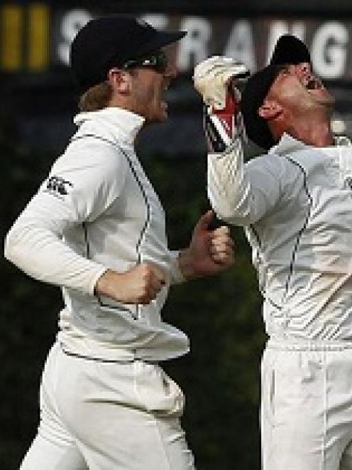 New Zealand's Kane Williamson and Kruger van Wyk celebrate after winning the second and final...