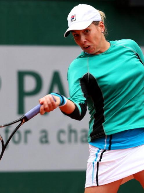 New Zealand's Marina Erakovic plays a forehand against Slovakia's Dominika Cibulkova during their...