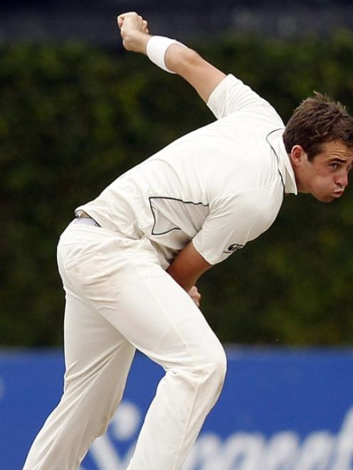 New Zealand's Tim Southee bowls during the third day of the second and final test cricket match...