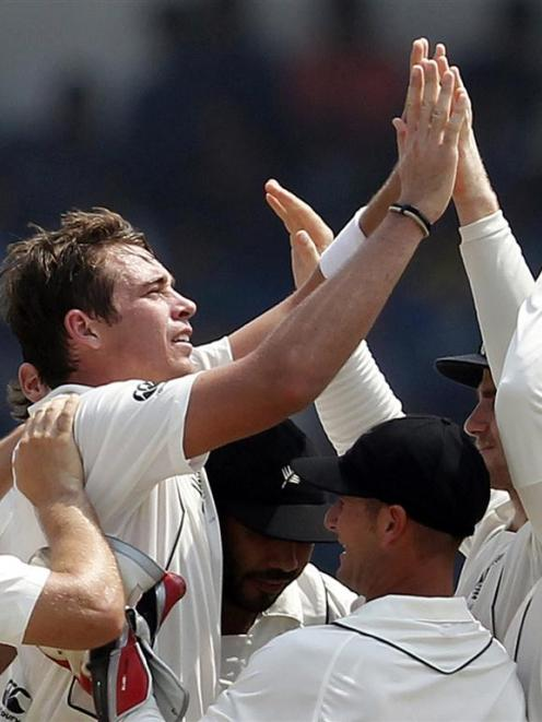 New Zealand's Tim Southee celebrates with teammates after taking the wicket of Sri Lanka's Thilan...
