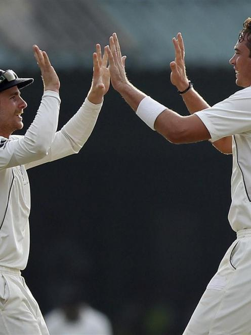 New Zealand's Tim Southee (right) has beenn ruled out of the South African tour. REUTERS/Dinuka...