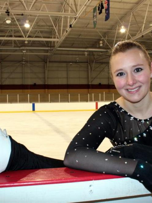 New Zealand senior women's figure skating champion Sarah MacGibbon (18) winds down after practice...