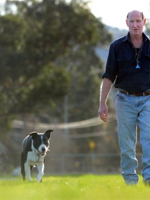 New Zealand Sheep Dog Trial Association president Graham White at home on the Taieri with Moss...