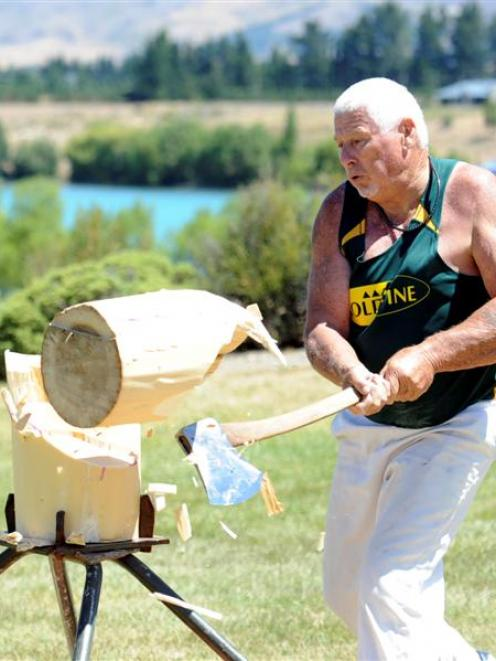 New Zealand veteran axeman  Terry Rice (67), of Christchurch, competes in the standing block...