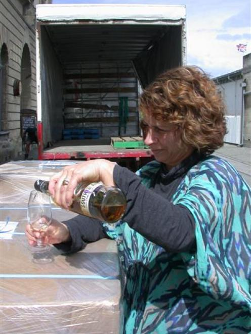 New Zealand Whisky Co manager Deb Preston celebrates the shipment of whisky about  to begin its...