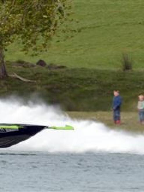 New Zealander John Derry so far leads the 2013 U.I.M World Championship Jet Boat Marathon at the...