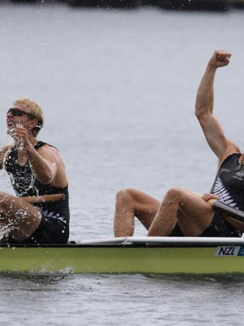 New Zealanders  Hamish Bond and Eric Murray celebrate after winning gold in the final of the men...