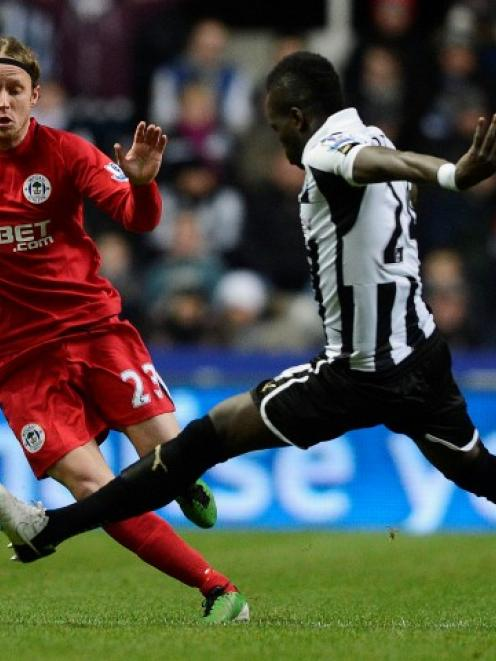 Newcastle United's Cheick Toite (R) challenges Wigan Athletic's Ronnie Stam during their English...