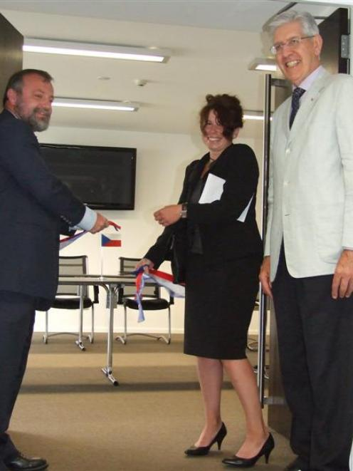 Newly appointed honorary consul of the Czech Republic Vladka Kennett (centre) cuts the ribbon to...