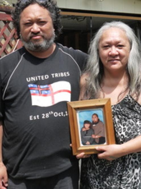 Nicholas Harris' mother Te Enga and his brother Brendon with a photo of Nicholas at their...