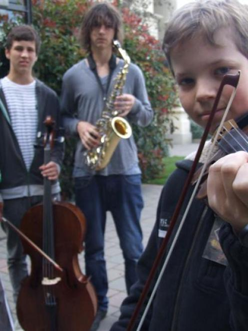Nick Majic (13) plays his violin at Waitaki Boys' High School yesterday, watched by his brothers...