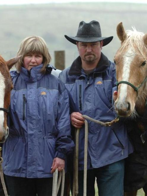 Nicky and Neil Rutherford with Solo (left) and River (right) yesterday. Another of their horses,...