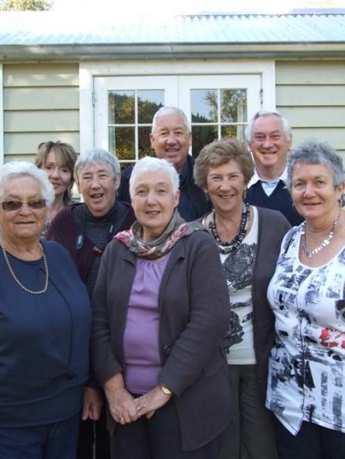 Nine of Thomas and Beatrice McMullan's grandchildren in front of the family cottage in Lawrence. ...