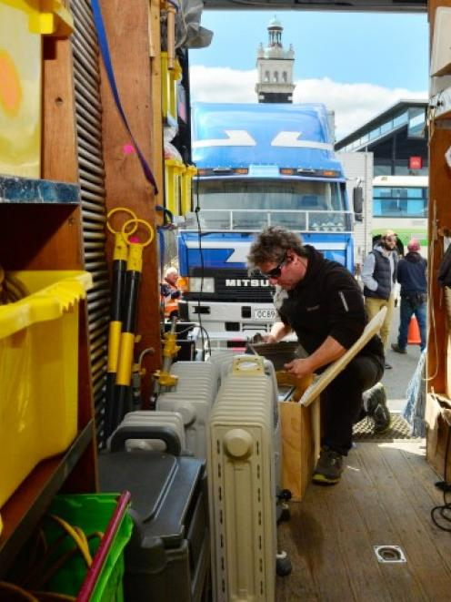 Unit manager Paul Stieglbauer sorts equipment in the film crew compound in the car park between...