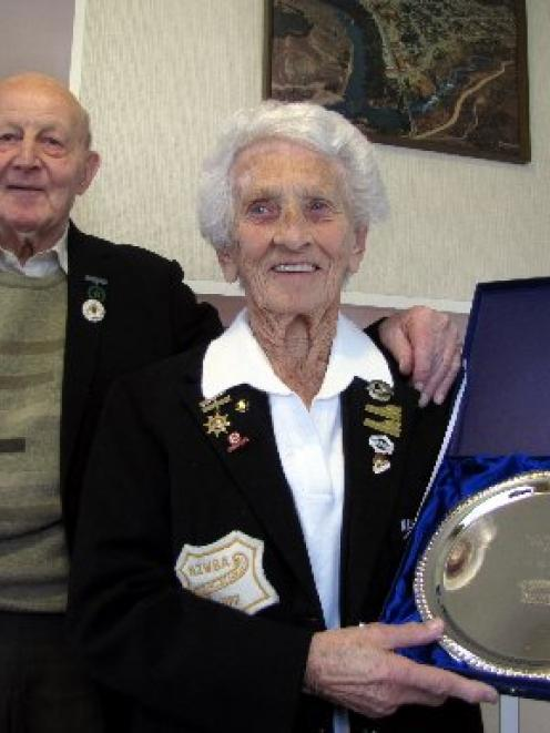 Noeleen Scott, of Cromwell, with husband Bill and the plate she was given when inducted into the...