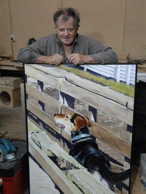 Norman Sinclair with one of his paintings of a huntaway dog,  <i>Roy In The Yards</i>. Photo by...