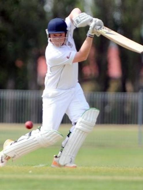 North East Valley batsman Tom Griffin square drives a ball for four during his innings of 29 in...