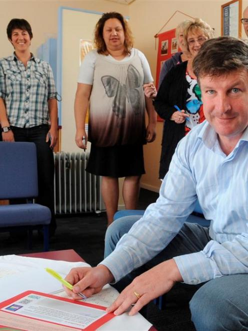 North East Valley Normal School teacher and NZEI site representative Michael Andrew signs a...