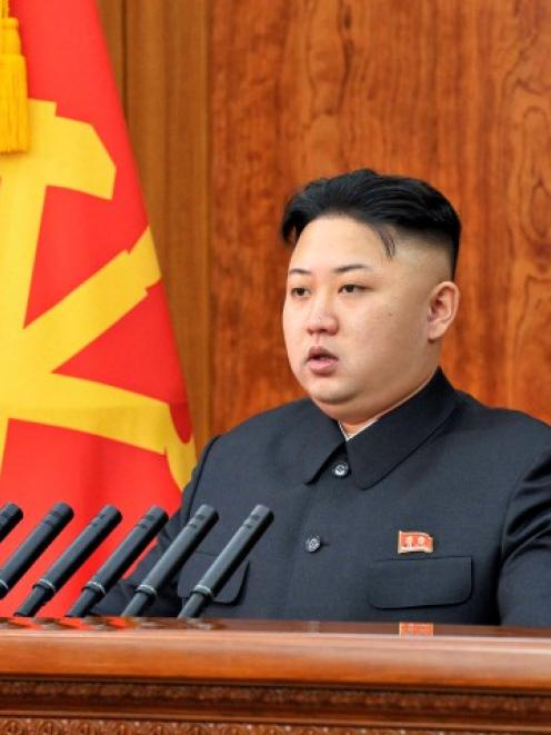 North Korean leader Kim Jong-un delivers a New Year address in Pyongyang in this picture released...