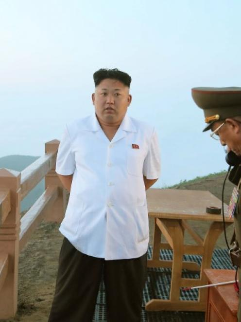 North Korean leader Kim Jong Un guides a tactical rocket firing drill of the KPA Strategic Force....