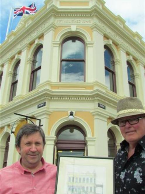 North Otago Club president Peter Garvan (left) and architect Ian Butcher show the original sketch...
