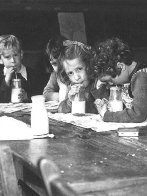 Northeast Valley School pupils drink their milk in the 1950s. Photo by Evening Star.