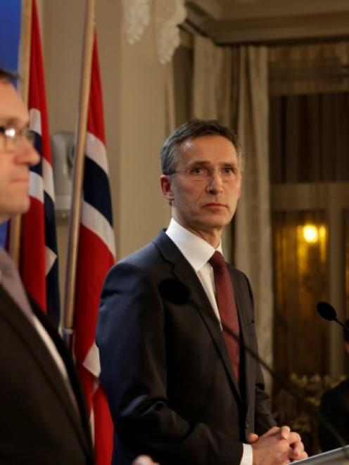 Norway's Prime Minister Jens Stoltenberg (C) and Minister of Foreign Affairs Espen Barth Eide...