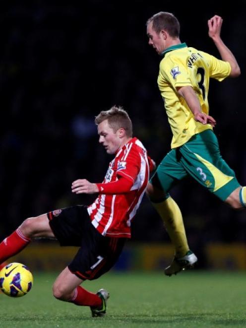 Norwich City's Steven Whittaker (R) challenges Sunderland's Sebastian Larsson during their...