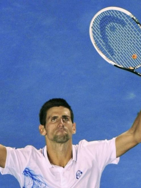 Novak Djokovic of Serbia celebrates after defeating David Ferrer of Spain in their quarterfinal...