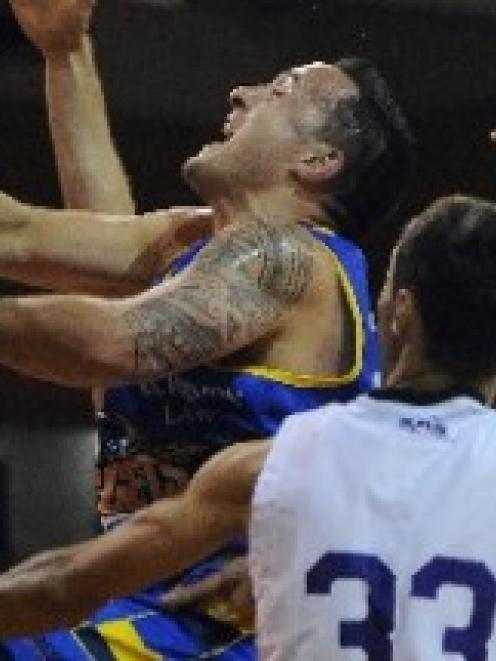 Nuggets forward Brendon Polyblank is clobbered by Rangers defender Christoph Fahrensohn at the...