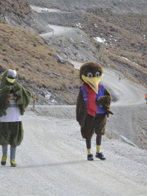 NZski mascots Spike and Shred run the final kilometre to the Remarkables base building.