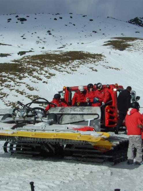 NZSki staff prepare to board a snow-groomer  to  help in the grid search on Thursday. Photo by...
