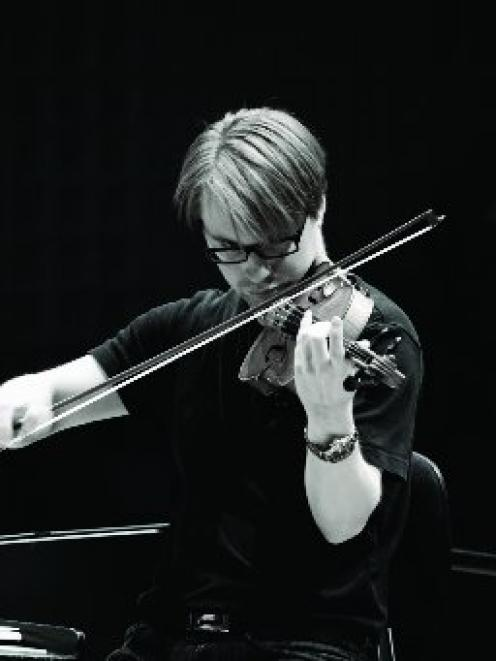 NZSO music director Pietari Inkinen plays the violin. Photo by Olivia Taylor.