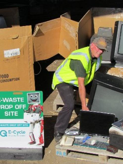 Waitaki Resource Recovery Park's Dave Clare (left) and Bev Searle prepare electronic waste for...