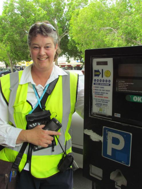Oamaru parking warden Tania  with one of the town's outdated parking meters. Photo by Andrew Ashton.
