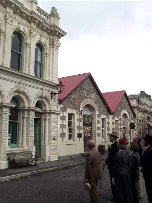 Oamaru Whitestone Civic Trust chairman Phil Hope (right)  points out features of historic...