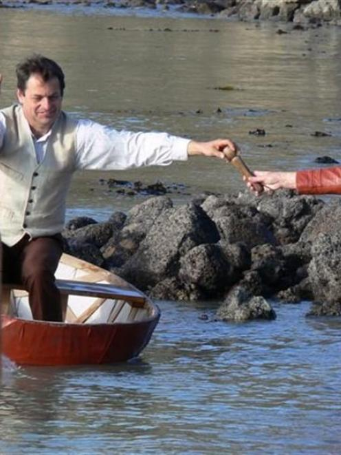 Over land and sea... John Baster hands the climate change relay baton to Helen Stead at Oamaru...