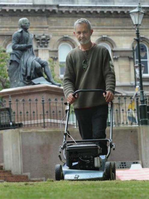 Occupy Dunedin protestor Kieren Trass cleans up the Octagon as Occupy Dunedin protest ends. Photo...