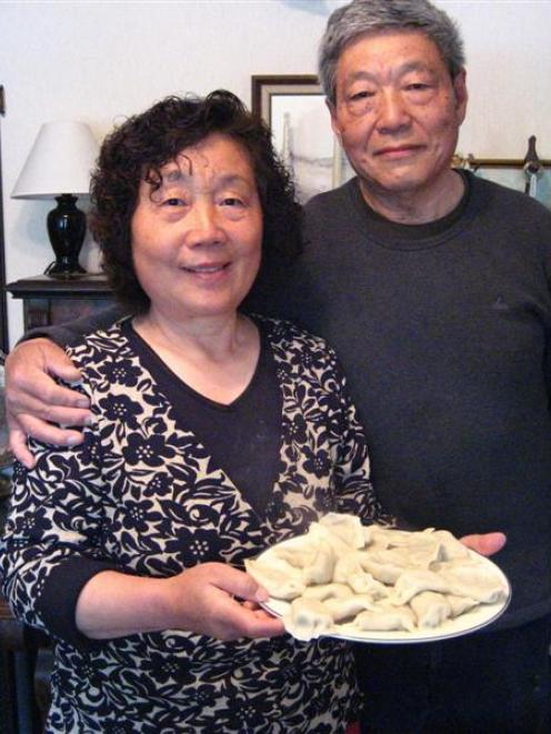 Of all the New Year foods, Ji Ying Xue (left) and Qi Rong Xie say dumplings are the most...