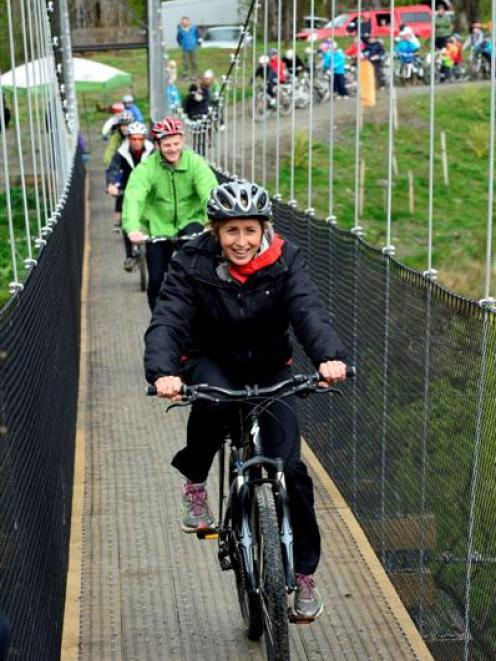 Olympic cyclist Sarah Ulmer and Deputy Prime Minister Bill English lead the first group of...