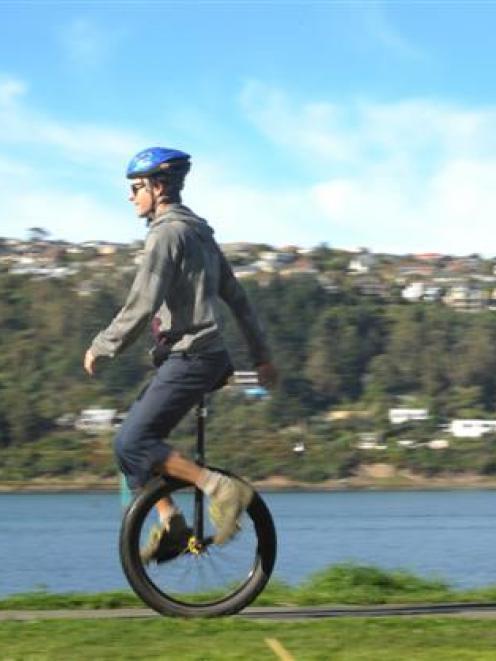 On One Unicyclists Dunedin club members Paul Cardno, Scott Kerr and Daniel Goodman ride their...