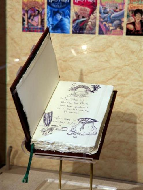 """One of only seven original copies of """"The Tales of Beedle the Bard,"""" created, handwritten and..."""