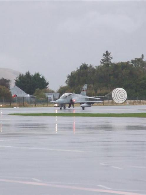 One of the three Hawk 127s arrives at Queenstown Airport on Tuesday evening, deploying a drogue...